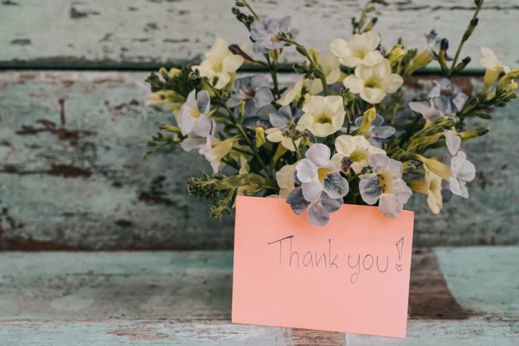 Thank you flowers and a handwritten card