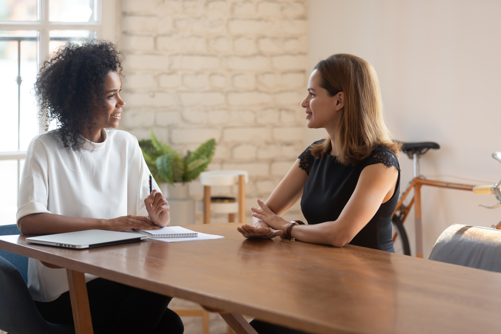 Two business women negotiating