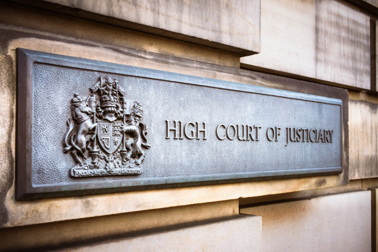 A sign next to the entrance door to the High Court of Justiciary in Edinburgh's Old Town.