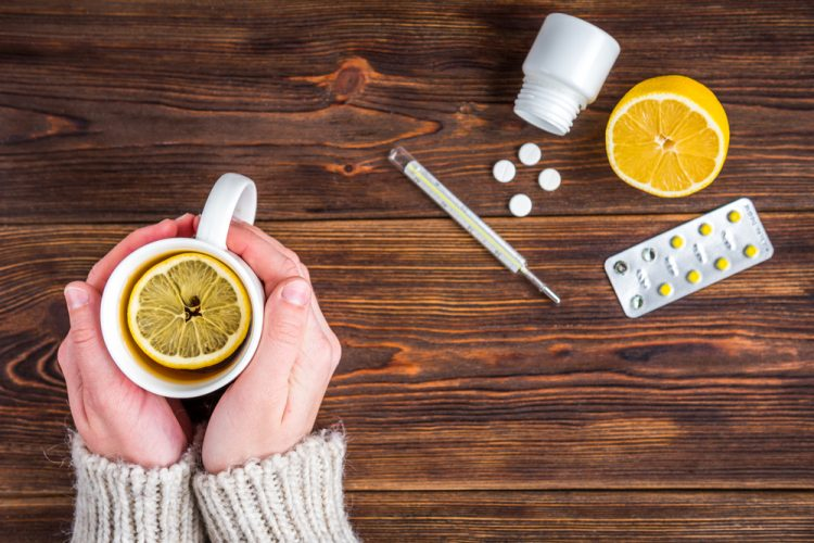 hot lemon drink, thermometer and tablets