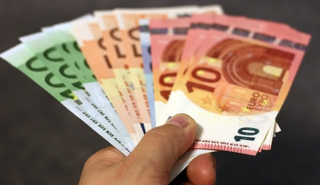 Handful of Euro notes - 7 simple ways to improve your cashflow