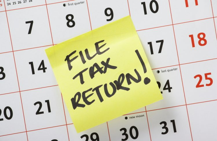 A handwritten note on a calendar about the Self-Assessment Tax Return