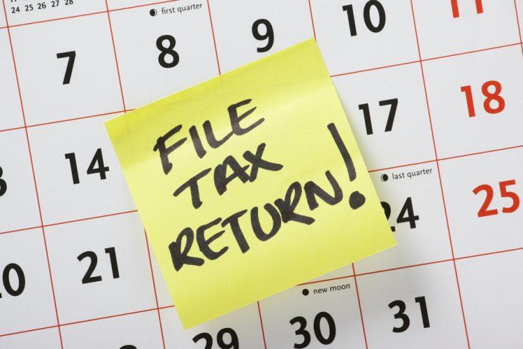 A handwritten note on a calendar about the Self-Assessment Tax Return